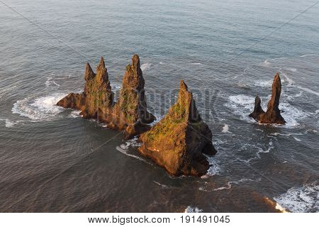 Southern Iceland, Cliffs Standing Out From The Atlantic Ocean Waters. Beautiful Sunset Scenery Near