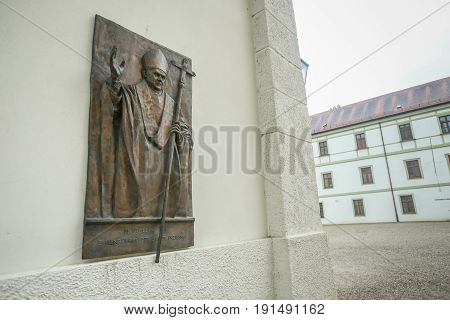 FREISING GERMANY - MAY 8 2017 : A wall sculpture of Pope Benedict XVI on Saint Mary and Corbinian Cathedral in Freising Germany.
