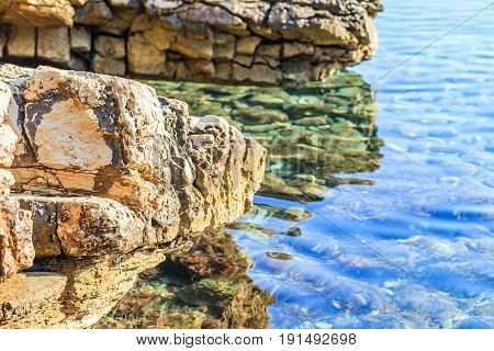 Landscape photo of rocky adriatic shore and crystal clear water