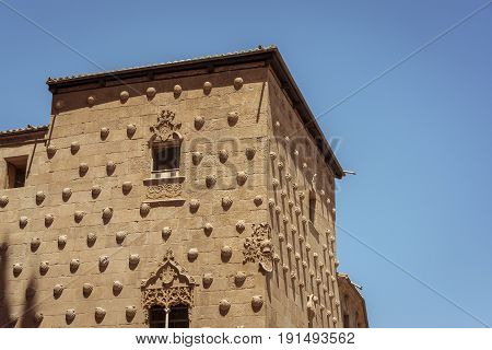 Facade and detail of the shells in Casa de las Conchas in Salamanca, Spain. exterior image shot from public floor. The Old city of Salamanca is declared by UNESCO a World Heritage Site.