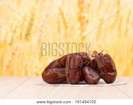 close up shot on dates sweet dried fruits on wooden background vegetable for diet with nutrition ingredient concept.