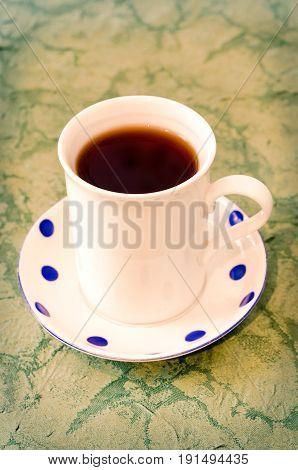 a tea cup on the table closeup