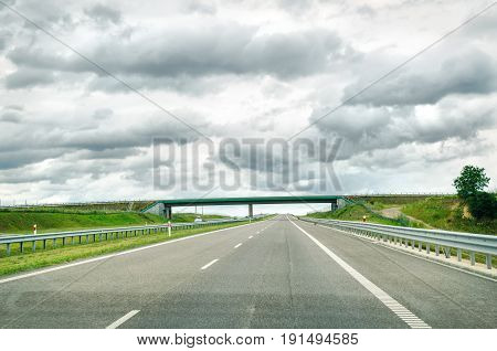 a highway view with road and sky