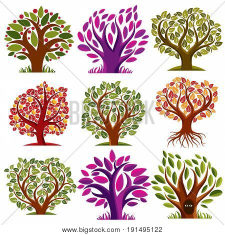 Vector stylized nature symbols art fruity trees collection. Gardening idea design elements fruitfulness theme. Two eyes of an animal looking from hollow graphic design ecology symbol.