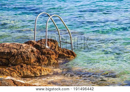 Photo of handrail on rocky adriatic coastline