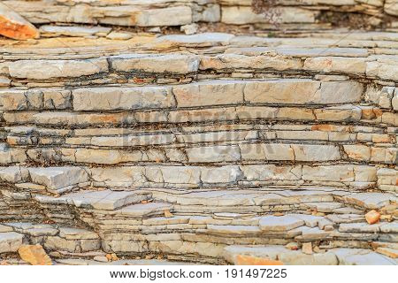 Close up photo of limestone texture rocky coastline