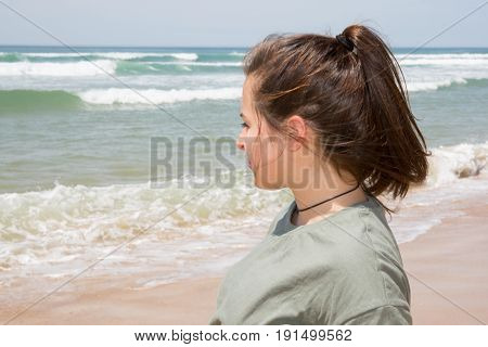 a teenager girl looking beach in summer