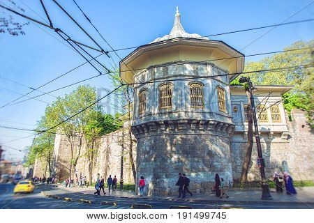 ISTANBUL TURKEY - MAY 2 2017: The Alay Pavilion and the wall of Gulhane Park Alemdar Caddesi