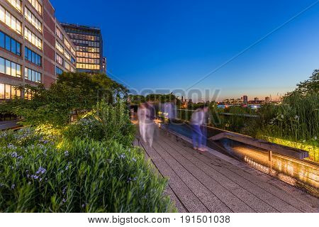 The Highline (High Line Park aerial greenway) at twilight in summer. Chelsea Manhattan New York City