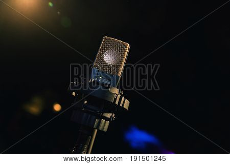 Microphone on stage. Microphone close-up. A pub. Bar. A restaurant. Classical music. Evening. Night show. European restaurant.