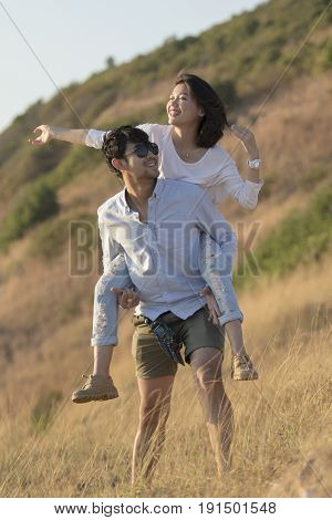 asian younger man and woman relaxing happiness emotion on traveling destination
