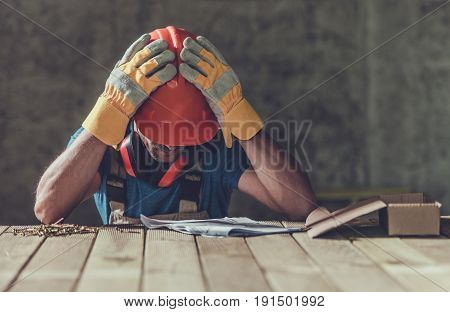 Disappointed Sad Caucasian Contractor Worker Facing Legal Problems. Bond Insurance Work Injury Concept Photo.