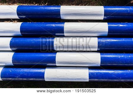 Poles blue white painted wood contrasted poles together equestrian show jumping equipment