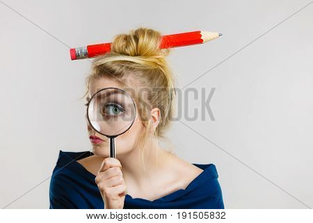 Woman Holding Magnifying Glass Having Hair Pencil