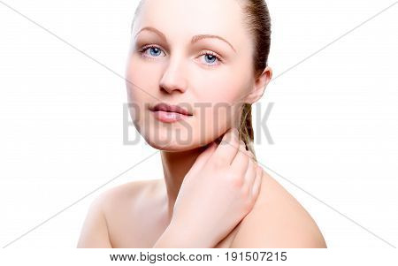 Portrait of girl with nude make-up with hand on neck isolated on white background. Girl with clean healthy skin on white. Cosmetology medicine beauty care. Nude makeup