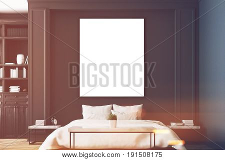 Luxury bedroom interior with gray and black walls a bookcase a double bed two bedside tables and wooden floor. Vertical poster. Close up. 3d rendering mock up toned image