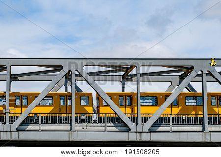 Berlin Germany - june 11 2017: Berlin subway train (U-Bahn) crossing bridge in Berlin Germany.
