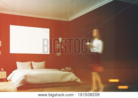 Woman in a modern luxury bedroom with black walls a large bed in the center of the room two bookcases by its sides a large window and a framed horizontal poster. Blank wall. 3d rendering mock up toned image