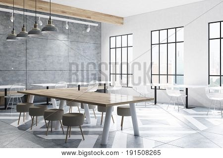 Corner of a modern cafe interior with concrete walls and a gray floor pattern tables and round chairs near tall windows. 3d rendering mock up