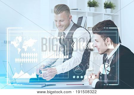 Close up of a young bearded businessman in a tie and his dark haired colleague sitting in a white office and working. Toned image double exposure