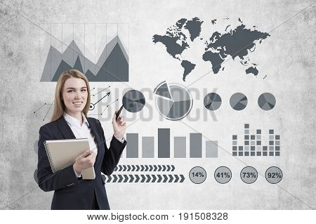 Image of businesswoman in grey suit drawing graph