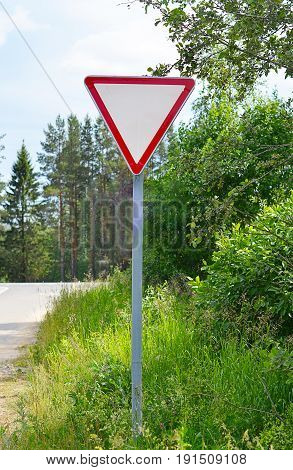 Road sign on the edge of slopes