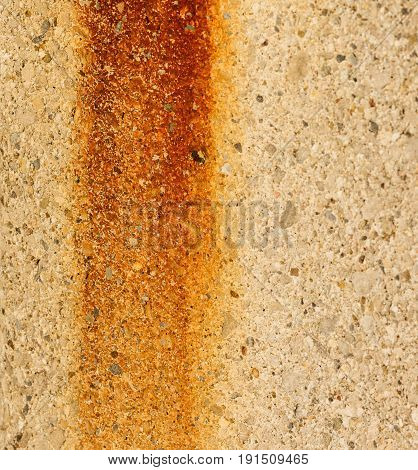 an abtract rust stain on a concrete light pole