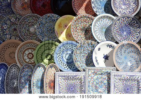 Several Tunisian pottery dishes exposed for to be sold to the public