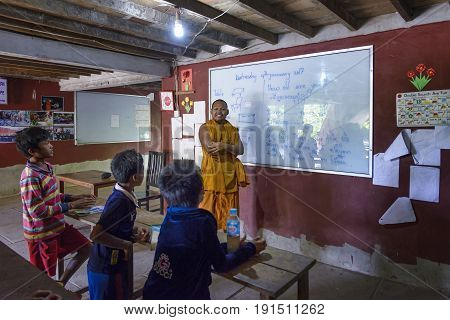 Lolei, Cambodia - January 04, 2017: A classroom in the rural Lolei village during an english lesson. The teaching is carried out by monks of the local temple and volunteers when they are available