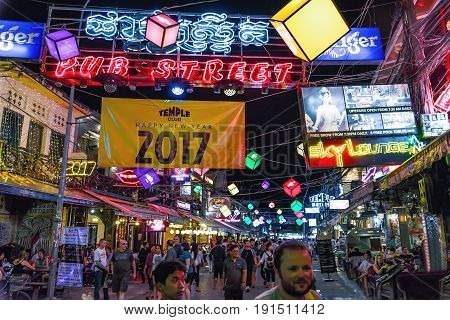 Siem Reap, Cambodia - January 02, 2017: View of Pub Street, the tourist center of the city. A road full of pubs and restaurants, which animates in the evening with bright lights and a lot of tourists