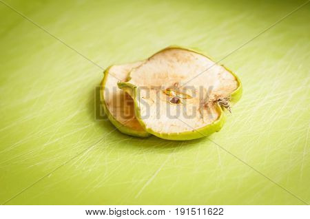 Two dry green apple slices stock image.