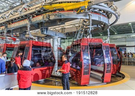 GENTING HIGHLANDS, MALAYSIA - APRIL 15, 2017: Tourists travel on cable car of Genting Skyway on April 15, 2017 in Malaysia. It is a gondola lift connecting Gohtong Jaya and Resorts World Genting.