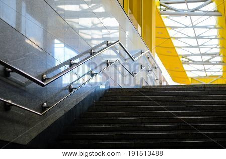 Stairs underpasses in the sunlight. Exit from the underground passage to the street. Cityscape background