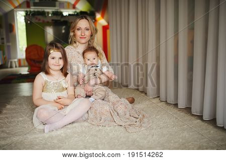 happy mother with daughter and son at home