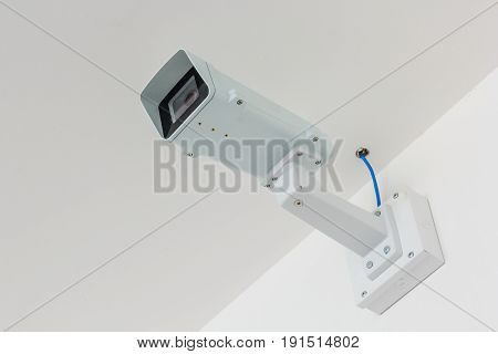 CCTV camera. Security camera on the white wall. Private property protection.