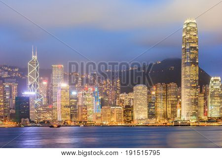 HONGKONG, CHINA - JULY 20: Night building colorful light beside Hongkong Victoria Harbor on July 20, 2013 in Hongkong China. Hongkong is a big international city in South of China.