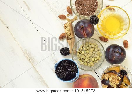 Healthy food - seeds berries yogurt granola and fruit. Diet concept,  space for text, top view