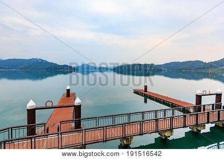 Long exposure of harbor with boats in the morning time at Sun Moon Lake Nantou city Taiwan