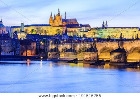 Panoramic view of Prague castle charles bridge and Vltava river in Prague at dusk Czech Republic