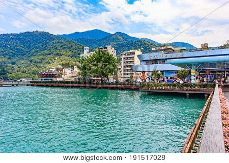 NANTOU, TAIWAN - MAY 01, 2017: Tourists like to visit the beautiful attractions around the sun moon lake by boat cruise from Shuishe Pier to Ita Thao Pier and then to Xuanguang Temple Pier