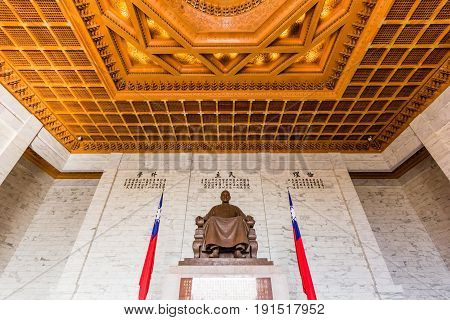 TAIPEI, TAIWAN - APRIL 29, 2017: The bronze statue of Chiang Kai-shek on April 29, 2017 in Taipei Taiwan. This statue is shown Chiang Kai-shek wearing traditional Chinese dress in the CKS memorial hall.