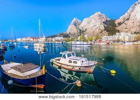 Waterfrontt view at coastal town Omis, popular touristic destination on Adriatic Sea, Croatia.