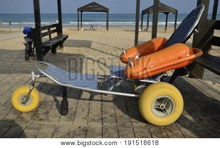 Special beach buggy for invalids under the canopy