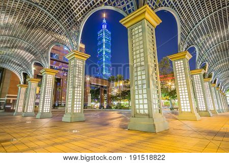 TAIPEI, TAIWAN - APRIL 29, 2017: Overlooking East Taipei Mall and Taipei 101 in Xinyi financial district at dusk Taipei Taiwan