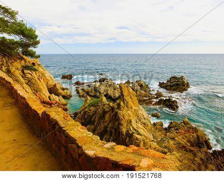 LLORET DE MAR, SPAIN - The beach in costa Brava of Catalonia Spain