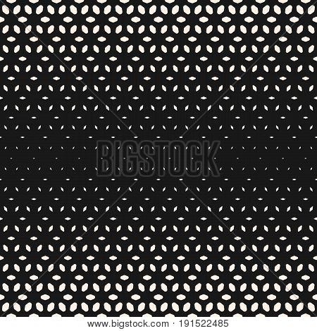 Halftone seamless pattern. Monochrome texture with gradient transition effect. Geometric background with different sized rounded shapes, falling petals. Perforated surface. Modern abstract design.