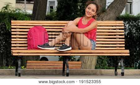 A College Student Sitting On Park Bench