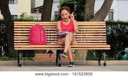 Creative Student Having An Idea Sitting on a Park Bench