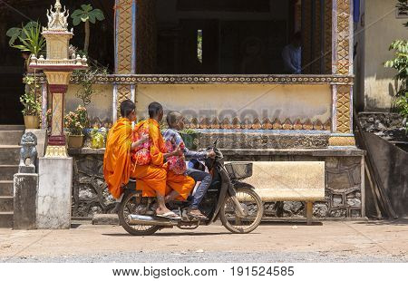 Three Young Monks Riding A Motorbike