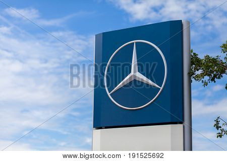 BURG / GERMANY - JUNE 11 2017: Mercedes-Benz logo near a trucking workshop. Mercedes-Benz is a global automobile manufacturer and a division of the German company Daimler AG.